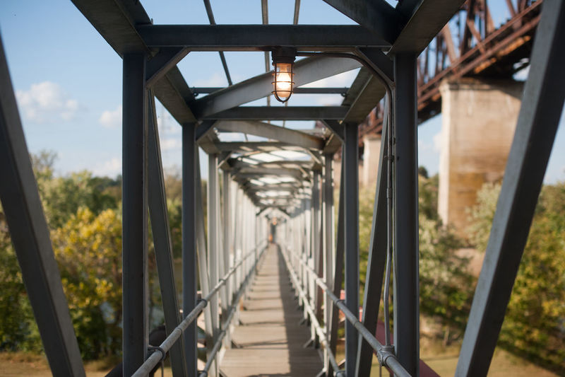 Empty illuminated footbridge