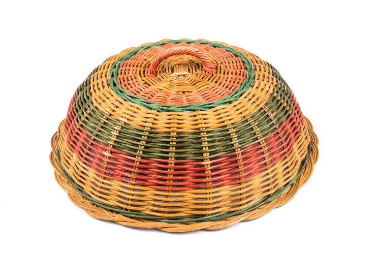 Traditional handmade rattan woven food cover from Malaysia Rattan Art And Craft Basket Close-up Cut Out Food Cover Handmade Indoors  Malaysia Multi Colored No People Single Object Still Life Studio Shot Traditional White Background Wicker