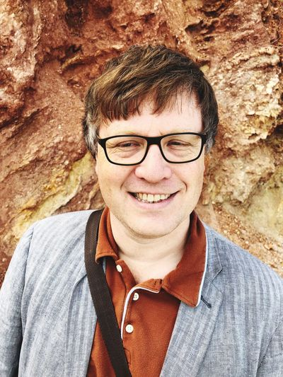 Man portrait on a beach in Ibiza in spring against rust coloured cliffs Rust Colured Portrait Real People Front View One Person Lifestyles Glasses Headshot Eyeglasses  Looking At Camera Smiling Young Adult Leisure Activity Close-up Young Men Adult Day Mid Adult Happiness Casual Clothing The Portraitist - 2018 EyeEm Awards