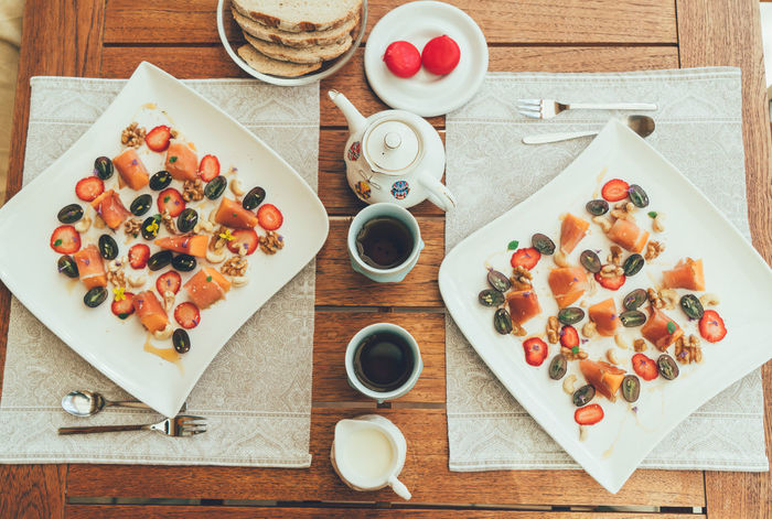 Breakfast Breakfast For Two Directly Above EyeEm Selects Food Food And Drink Freshness Fruit Healthy Eating Healthy Food Healthy Lifestyle High Angle View Indulgence No People On The Table Plate Ready-to-eat Still Life Table Tea Wood - Material Wooden Table Yummy