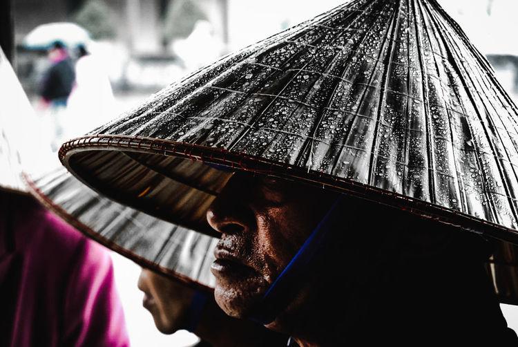 Portrait of man with umbrella