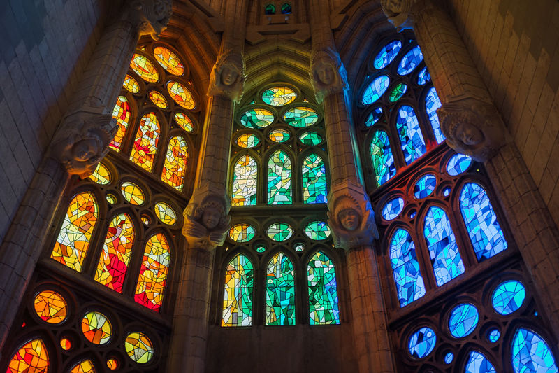 Low Angle View Of Designed Stained Glass Windows At Sagrada Familia