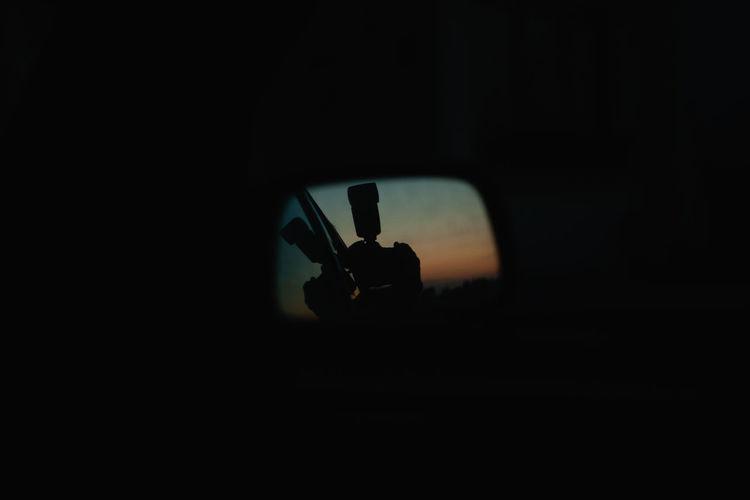 Silhouette person holding cigarette in the dark