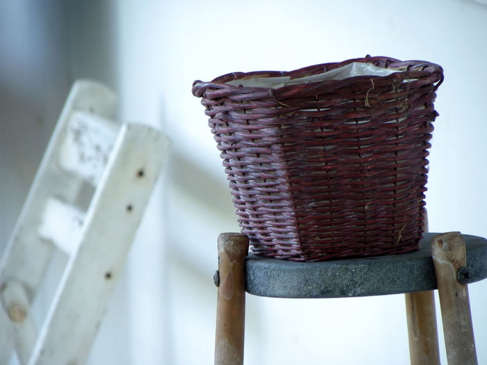 Close-up of whicker basket on table