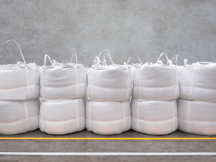 Stacking of bulk cargo in jumbo bags are store in warehouse. BIG Jumbo LINE Logistics Rice Sugar Bags Bulk Cargo Export Factory Flour Freight Ground Import Industry Sacks Secure Shipment Silicon Stacking Starch Stock Tapioca Warehouse