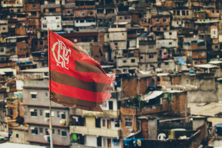 Close-up of flamengo soccer club flag against buildings in city