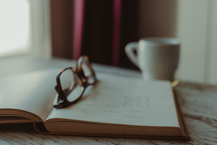 Coffee Coffee Break Coffee Time Studying Reading A Book Book Old Book French Vocabulary Education Learning Eyeglasses  Glasses Close-up No People Indoors  Drink Still Life Paper Cup Mug Publication Table Eyeglasses  Open Pen Absence Page Focus On Foreground Selective Focus