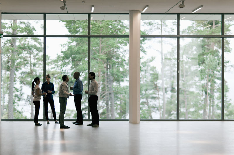 Group of people standing by window