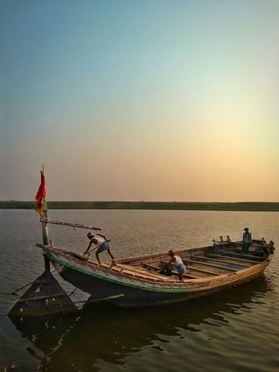 Outdoors Nature Clear Sky Day Bihar, India Rural Scene Riverside Nautical Vessel Nature Photography Planet Earth Greenery Nature_collection Beauty In Nature Indiapictures Boat Sunset Occupation Water Sky Fisherman People Business Finance And Industry Tranquility Fishing Adult