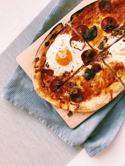 Pretty much anything can become breakfast when you add an egg to it 😜 Cooked Stonebaked Pepperoni Egg Food Pizzalover Pizza Time Pizza Indoors  Food And Drink No People Close-up Food Tablecloth Ready-to-eat