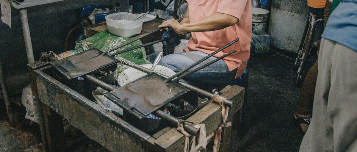 Midsection Of Man Cooking Food At Don Wai Market
