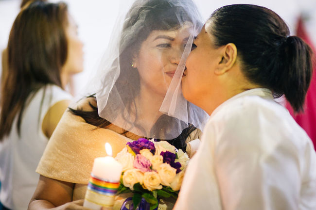 After being together for 2 years, Marilyn (43) and Dhey (42) wanted to get married and start their own family. Marily's friend played the matchmaker by introducing them to each other 3 years ago. They're one of 8 couples who participate in the LGBT Mass Wedding in Quezon City, Manila on Sunday, despite that the same-sex marriage isn't legally recognized in Philippines yet. Eyeem Philippines Lesbiancouple Lesbianwedding Lgbt Lgbt Wedding LGBTQ Rights Love Loveislove Photojournalism Showcase June Twobrides Wedding EyeEm Diversity Resist The Photojournalist - 2017 EyeEm Awards This Is Queer This Is Family Focus On The Story Love Is Love