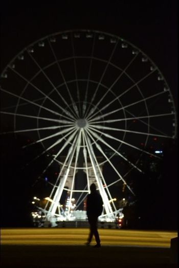 Full Length Rear View Leisure Activity Ferris Wheel Silhouette Sky Illuminated One Person Night People Outdoors Adults Only Ice Rink Adult Paris eifel Eifeltour Paris❤ Eifel Tower Parisienne France Photos Paris Streets