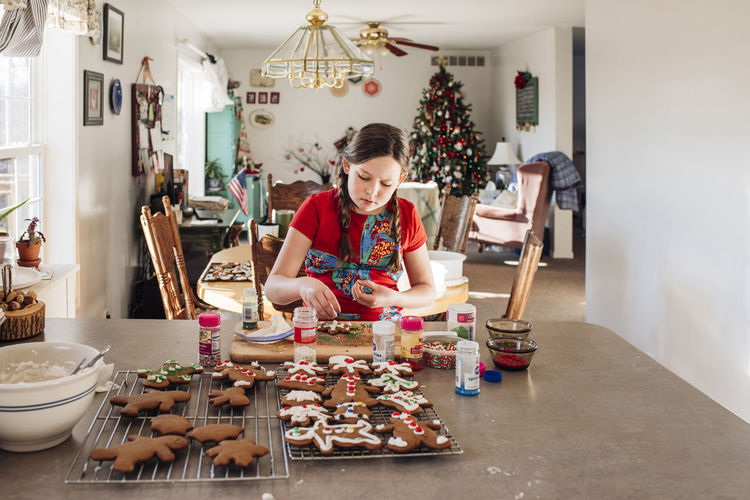 Woman holding food on table at home
