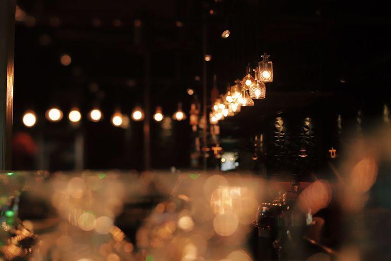 Cinematic lounge bar Night Illuminated Architecture City Restaurant Built Structure Building Exterior Focus On Foreground Business Lighting Equipment Defocused Glass Decoration Lens Flare Lifestyles Celebration