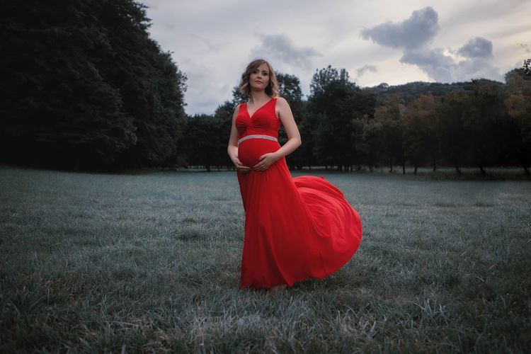 Pregnant woman standing on grass