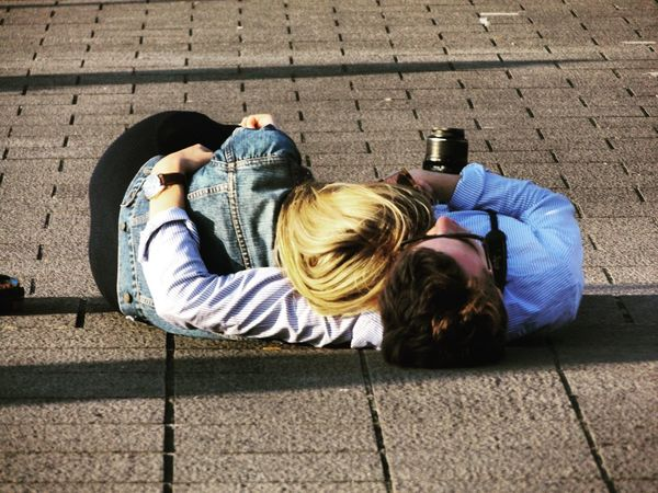 two can win. Two People Lying Down Couple - Relationship Outdoors High Angle View Togerherness Day Friendship