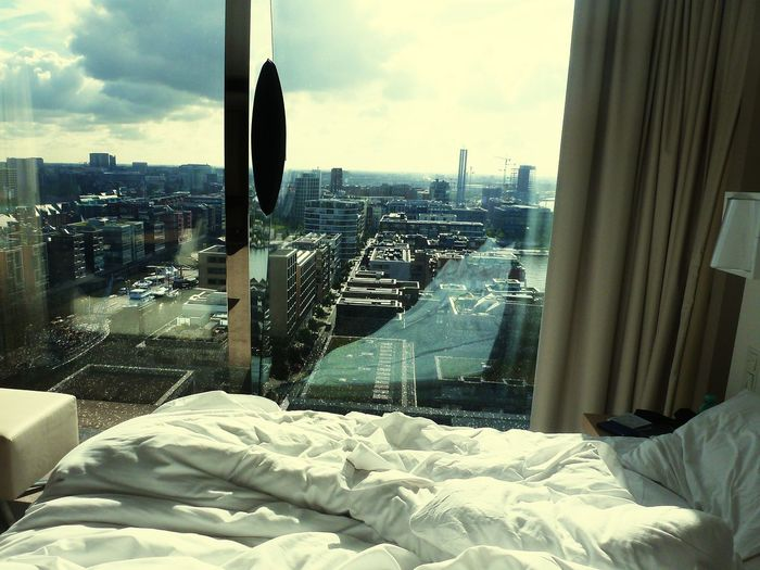 oh ... it's a beautiful morning! Cityscape Urban Skyline Architecture Looking Through Window Bedroom Hotel Room Hamburg Room With A View Elbphilharmonie City No People Indoors  Modern Morning View Sky And Sea Breathing Space The Week On EyeEm Your Ticket To Europe Mix Yourself A Good Time Stories From The City Adventures In The City Modern Hospitality