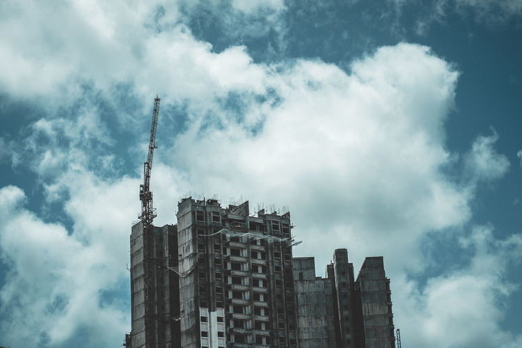 Blue sky and grey stones Built Structure Building Exterior Architecture Sky Low Angle View Cloud Cloud - Sky City Tall - High Cloudy Tower Building Cloudscape High Section Development Outdoors Day Storm Cloud Skyscraper Construction First Eyeem Photo