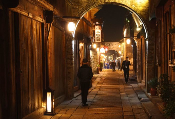 old, long narrow street in Wuzhen Watertown. Wuzhen Watertown Chinese Town Village Life Night Lights People Vintage Oriental Chinese Style Cultures Traditional Jiangnan 江南 水乡