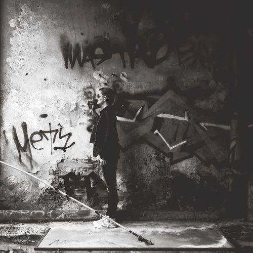 Woman standing in graffiti