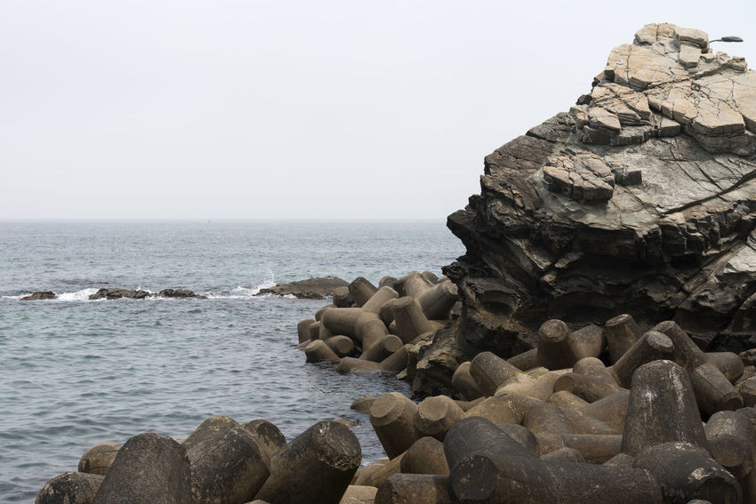 seaside view at Simgok in Gangreung, Gangwondo, South Korea Beauty In Nature Clear Sky Day Horizon Over Water Nature No People Outdoors Rock - Object Rock Formation Rocks Scenics Sea Seaside Sky Tranquil Scene Tranquility Water
