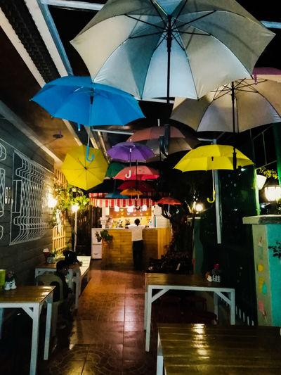 Exterior of 581 Garden Cafe Cafe Multi Colored Umbrella Bar Counter Rainy Season Outdoor Cafe Happy Hour