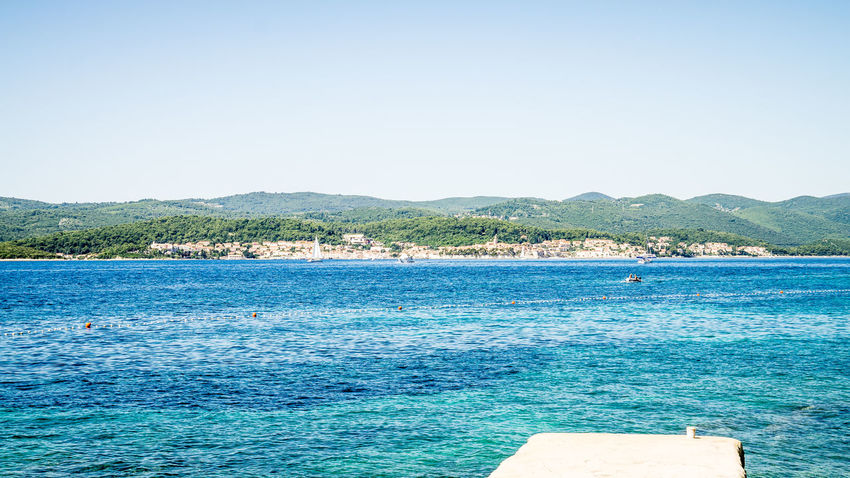 View to the island of Korcula Beauty In Nature Blue Clear Sky Croatia Day Landscape Nature No People Orebic Outdoors Photography Scenics Sea Sea And Sky Seascape Sky Swimming Pool Tranquil Scene Tranquility Travel Destinations Tree Water