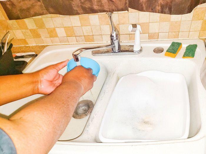 woman rinsing a