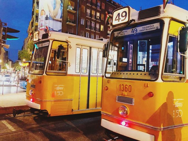 Trams in Budapest are a popular form of public transport. Evening Night Journey City Travel Transportation Budapest Trams Tram Mode Of Transportation Transportation Text Communication Architecture Public Transportation Land Vehicle City Yellow Outdoors Street