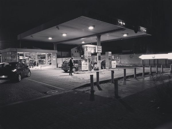 Night Illuminated Transportation Built Structure Land Vehicle Real People Architecture Men Outdoors Fuel Pump Mammal People Gasstation Tankstelle IPhoneX IPhoneography