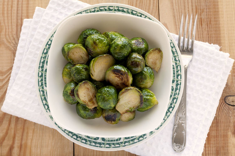 Roasted Brussels Sprouts Bowl. Green Green Color Roasted Brussel Sprouts! Vegetarian Vegetarian Food Bowl Braised Brussels Sprout Cruciferous Directly Above Food Food And Drink Fork Freshness Healthy Eating Healthy Lifestyle No People Plate Ready-to-eat Roasted Studio Photography Vegan Vegan Food Vegetable Wooden Background