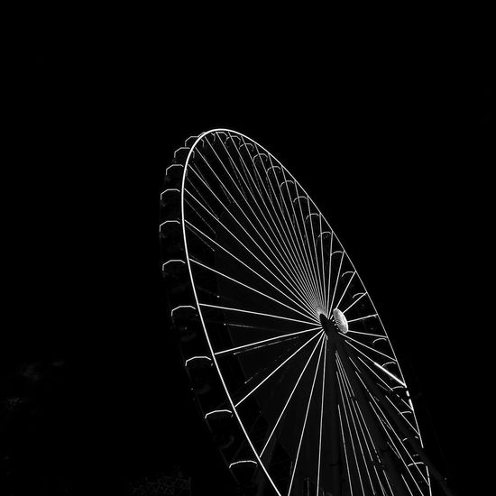 Ferris Wheel Amusement Park Amusement Park Ride Night Sky Arts Culture And Entertainment Low Angle View No People Copy Space Nature Clear Sky Dark Shape Illuminated Geometric Shape Circle Outdoors Pattern Metal Fairground