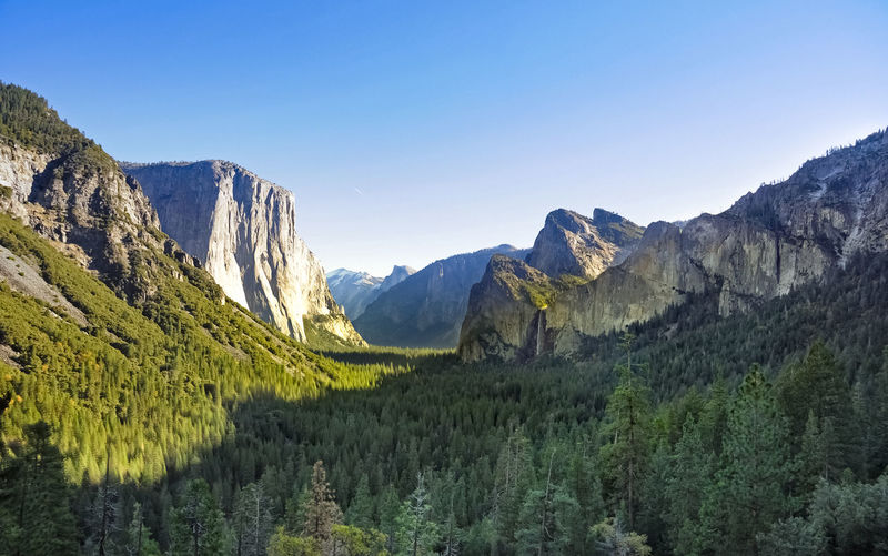 Yosemite Park valley Panorama Valley Yosemite National Park Mountain Environment Landscape No People Beauty In Nature Scenics - Nature Mountain Range Nature Formation Idyllic Land Non-urban Scene Panorama Clear Sky Day Tranquil Scene Sky Grass Famous Place Travel Destinations
