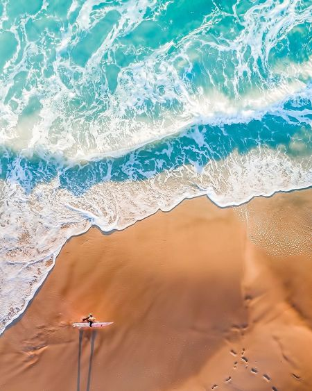 Aerial View Dronephotography Land Water Sea Beach Sand One Person Lifestyles Beauty In Nature Vacations Leisure Activity Nature Sunlight Motion Outdoors Holiday Trip Adult Travel Wave