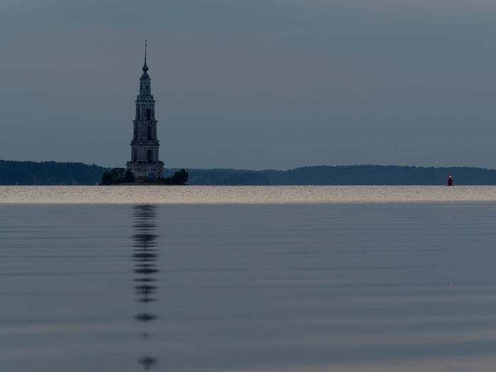 Mid distance view of kalyazin bell tower in volga river at dusk