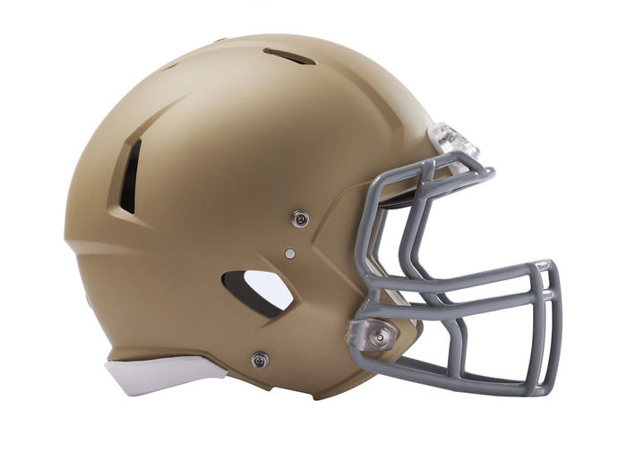 Modern football helmet isolated on a white background Football Gold Isolated Low Angle View Modern Profile Uniform Facemask Gray Headwear Helmet No People Object Professional Protection Safety Side View Sports Equipment Sports Helmet White Background