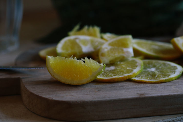 Close-up of orange slices on cutting board in kitchen
