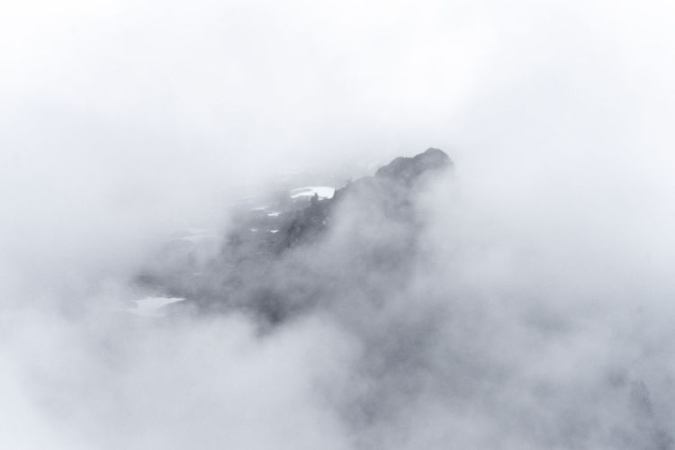 Low angle view of fog against sky