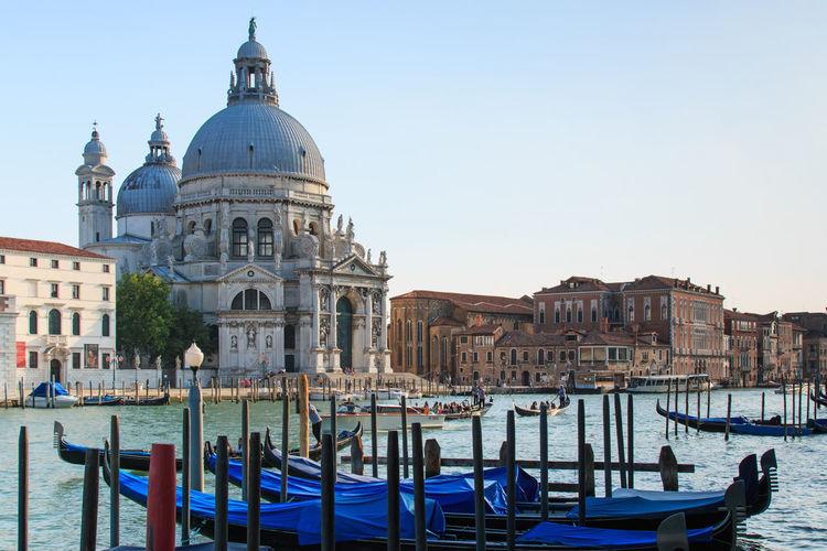 Santa maria della salute by grand canal against sky
