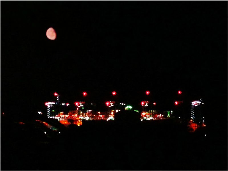 Waning gibbous red Moon over the harbour lights. Waning Gibbous Moon Red Moon Night No People Outdoors Smartphone Photography Camera FV-5 Illuminated Astronomy Sky Cranes Panamax Harbor Nature Industrial Landscapes Moon Red Lights