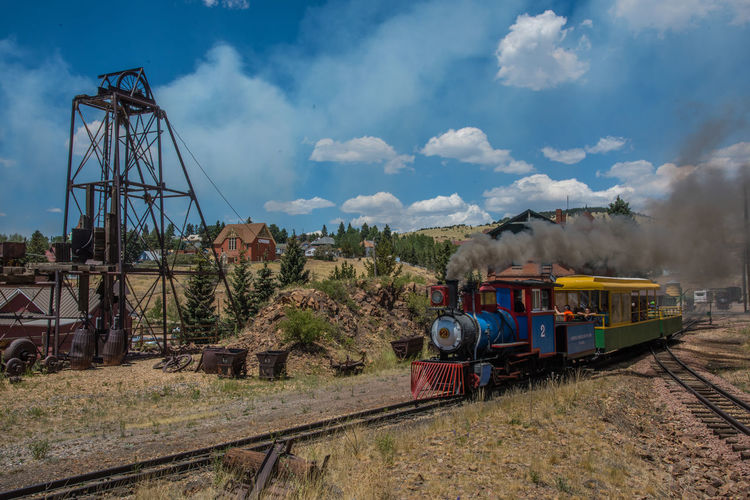 Jun 2018 - Cripple Creek And Victor Narrow Gauge Railway 19th Century Narrow Gauge Railway Architecture Cloud - Sky Day Gold Mining Town Land Land Vehicle Mode Of Transportation Nature Outdoors Public Transportation Rail Transportation Railroad Track Sky Smoke - Physical Structure Steam Train Track Train Train - Vehicle Transportation Travel
