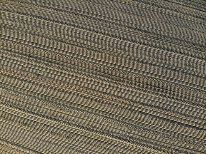 Field Full Frame Pattern Backgrounds Textured  High Angle View No People Textile Close-up Day Nature Metal Outdoors Material Brown Agriculture Repetition Landscape Land In A Row Wood Grain