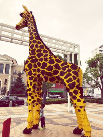 Giraffe 麒麟 きりん Built Structure Architecture Building Exterior Sky Celebration Nature Belief Decoration Art And Craft No People Spirituality Outdoors Representation Religion Building Day City Creativity