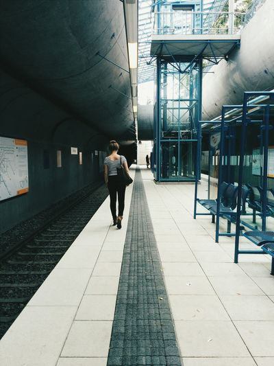 Back view of a young at metro station