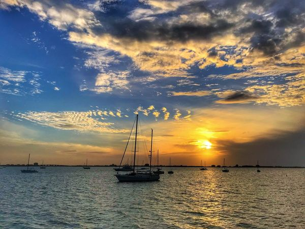 Florida Sunset NEM Mind NEM VSCO Submissions NEM Clouds NEM Submissions Sunset Sea Nautical Vessel Sky Scenics Cloud - Sky Water Outdoors Dramatic Sky Horizon Over Water No People Tranquil Scene Beauty In Nature Tranquility Boat Nature Mode Of Transport Mast Waterfront Transportation