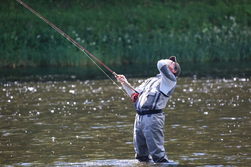Man Fishing In Water