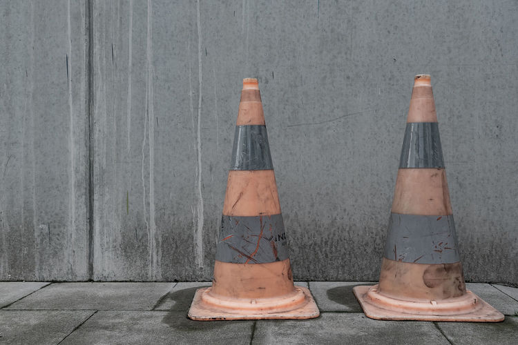 View of traffic cones against wall