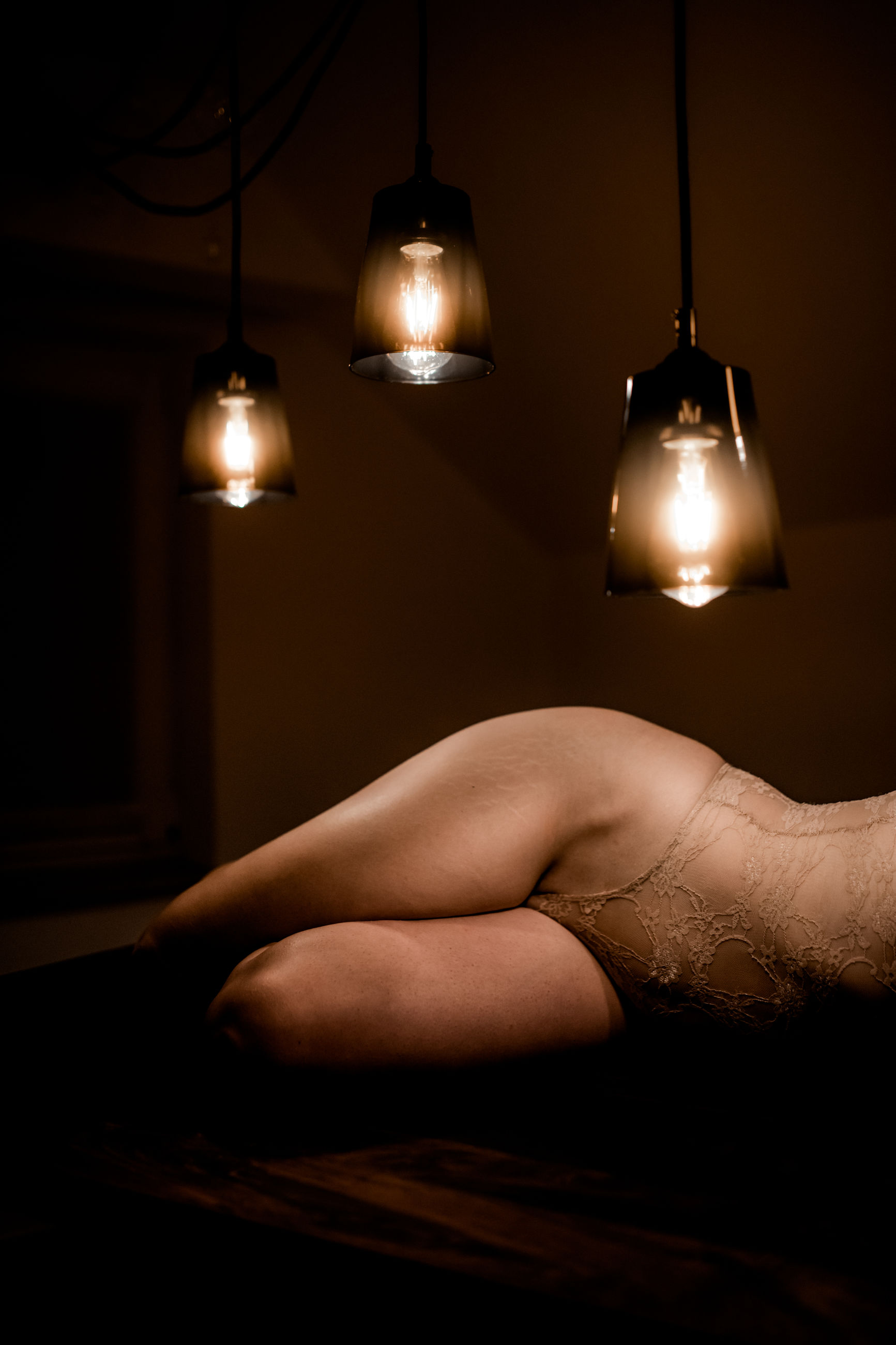 illuminated, lighting equipment, indoors, one person, glowing, human body part, real people, electricity, adult, lifestyles, electric lamp, women, hanging, relaxation, light bulb, leisure activity, electric light, hand, light