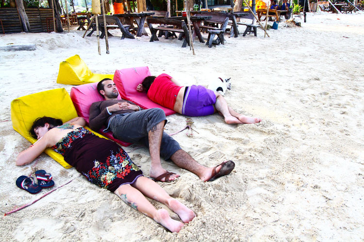 Drunk people on the beach at PP Koh Island, Krabi, Thailand Drunken Friends Good Dream Morning Sandals After Party Alcoholic Drink Beach Beside Dog Drucker Lying Down Men Outdoor Outdoors People Real People Relaxation Sand Sand Dune Sea Sleeping Togetherness Vacations Woaman